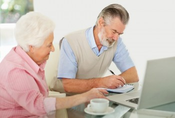 Mature couple planning their monthly budget